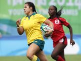 Tiana Penitani of Australia runs with the ball and scores a try at the Rugby Sevens Final on day four of the Nanjing 2014 Summer Youth Olympic Games at the Olympic Sports Park on August 20, 2014 in Nanjing, China.