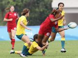 Brooke Anderson of Australia tackles Charity Williams of Canada  at the Rugby Sevens Final on day four of the Nanjing 2014 Summer Youth Olympic Games at the Olympic Sports Park on August 20, 2014 in Nanjing, China.