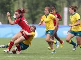 Laura Waldie of Australia tackles Maddy Seatle of Canada at the Rugby Sevens Final on day four of the Nanjing 2014 Summer Youth Olympic Games at the Olympic Sports Park on August 20, 2014 in Nanjing, China.