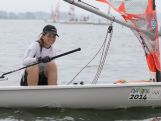 NANJING, CHINA - AUGUST 23:  Elyse Ainsworth of Australia is seen in the waters after the race fails to start due to low wind condition in the Byte CII - Women's One Person Dinghy Final on day seven of Nanjing 2014 Summer Youth Olympic Games at Jinniu Lake Sailing Venue on August 23, 2014 in Nanjing, China.