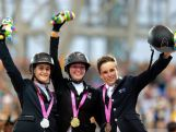 NANJING, CHINA - AUGUST 24:  (CHINA OUT) (L - R) Silver medalist Martina Campi of Argentina, Gold medalist Emily Fraser of New Zealand and Bronze medalist Jake Hunter of Australia celebrate on the podium after the Equestrian Individual Jumping Final on day eight of the Nanjing 2014 Summer Youth Olympic Games at Xinzhuang Equestrian Venue on August 24, 2014 in Nanjing, China.