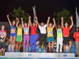 (L-R) Ioana Teodora Gheorghe of Romania, Lakeisha Ashley Warner of Virgin Islands, Tatiana Blagoveshchenskaia of Russia, Maria Simancas of Venezuela, Witthawat Thumcha of Thailand, Trae Williams of Australia, Daou Bacar Aboubacar of Comoros and Merten Howe of Germany celebrate on the podium during the medal ceremony after the 8x100m Mixed Team Relay Final at Yanshan Road AT 8x100m Venue on day ten of the Nanjing 2014 Summer Youth Olympic Games on August 26, 2014 in Nanjing, China.