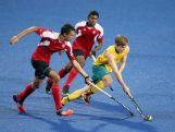 Mackenzie Warne of Australia (R) competes the ball against Balraj Panesar  (L) and Floyd Mascarenhas (C) of Canada in Hockey5s Men's Gold Medal Match on day eleven of the Nanjing 2014 Summer Youth Olympic Games at Nanjing YOG Sports Park Hockey Field on August 27, 2014 in Nanjing, China.