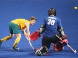 Alec Rasmussen of Australia (L) shoots a goal against Liam Manning of Canada (R) in Hockey5s Men's Gold Medal Match on day eleven of the Nanjing 2014 Summer Youth Olympic Games at Nanjing YOG Sports Park Hockey Field on August 27, 2014 in Nanjing, China.