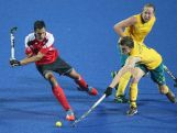Tim Howard of Australia (R) competes the ball against Balraj Panesar of Canada (L) in Hockey5s Men's Gold Medal Match on day eleven of the Nanjing 2014 Summer Youth Olympic Games at Nanjing YOG Sports Park Hockey Field on August 27, 2014 in Nanjing, China.