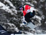 Jarryd Hughes of Australia takes to the air during the men's qualification run at the 2013 Snowboard Cross World Cup in Lake Louise, Canada.