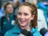 Australian Freestyle skier Taylah O'Neill speaks to the media as she arrives at Sochi International Airport prior to the Sochi 2014 Winter Olympics on January 31, 2014 in Sochi, Russia.