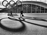 TV journalists are seen in front of the Bolshoy Ice Dome in the Olympic Park prior to the Sochi 2014 Winter Olympics on February 1, 2014 in Sochi, Russia.