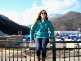 Torah Bright of Australia poses in front of a construction zone after an Australian Olympic Team Snowboard and Freestyle Press Conference at Gorki Press Centre on February 2, 2014 in Sochi, Russia.