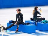 Short track speed skaters Emily Scott (L) of the United States and Deanna Lockett of Australia take a break during practice ahead of the Sochi 2014 Winter Olympics at Iceberg Skating Palace on February 3, 2014 in Sochi, Russia.