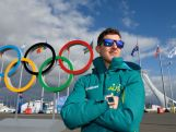 Daniel Greig strikes a pose in front of the Olympic rings in Olympic Park in Sochi,