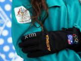 Australian snowboarder Hannah Trigger poses wearing competition wear during the Australian Olympic Team Uniform launch ahead of the Sochi 2014 Winter Olympics