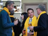 Lachlan Murdoch, James Tomkins and Peter Montgomery share a beer and a laugh while attending the ceremony to announce the Flag Bearer for Australia.