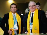 Lachlan Murdoch and Peter Montgomery share a beer while attending the ceremony to announce the Flag Bearer for Australia at the Sochi Olympics Opening Ceremony.
