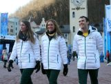 Emily Bamford, Lavinia Chrystal and David Morris of Australia make their way to the opening ceremony ahead of the Sochi 2014 Winter Olympics at Rosa Khutor on February 7, 2014 in Sochi, Russia.