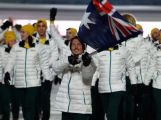 Snowboarder Alex Pullin of the Australia Olympic team carries his country's flag during the Opening Ceremony of the Sochi 2014 Winter Olympics at Fisht Olympic Stadium