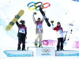 (L-R) Silver medalist Staale Sandbech of Norway, gold medalist Sage Kotsenburg of the United States and bronze medalist Mark McMorris of Canada pose on the podium during the flower ceremony following the Snowboard Men's Slopestyle Final during day 1 of the Sochi 2014 Winter Olympics at Rosa Khutor Extreme Park.