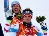 Bronze medalist Kjetil Jansrud of Norway (L) and gold medalist Matthias Mayer of Austria celebrate during the flower ceremony for the Skiing Men's Downhill at Rosa Khutor Alpine Center on February 9, 2014.