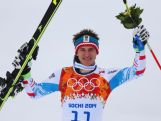 Gold medalist Matthias Mayer of Austria stands on the podium during the flower ceremony for the Skiing Men's Downhill at Rosa Khutor Alpine Center on February 9, 2014.