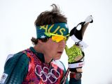 Callum Watson of Australia reacts at the finish line in the Men's Skiathlon 15 km Classic + 15 km Free during day two of the Sochi 2014 Winter Olympics at Laura Cross-country Ski & Biathlon Centre.