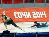 Daniel Greig of Australia falls in Race 1 in the Speed Skating event during day 3 of the Sochi 2014 Winter Olympics at Adler Arena Skating Centre.