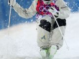 Brodie Summers competes in the Men's Moguls Finals on day three of the Sochi 2014 Winter Olympics at Rosa Khutor Extreme Park.