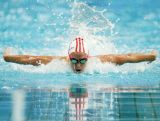 Emma McKeon competes in the Women's 100m Butterfly Semi Final during day one of the Australian National Swimming Championships on April 3, 2015.