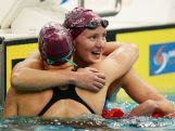 Jessica Ashwood (R) embraces Leah Neale (L) after winning the Women's 400m Freestyle Final during day one of the Australian National Swimming Championships on April 3, 2015.