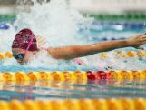 Emma McKeon competes in the Women's 100m Butterfly Final during day two of the Australian National Swimming Championships on April 4, 2015.