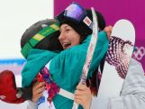 Devin Logan of the United States hugs Anna Segal after their runs in the Freestyle Skiing Women's Ski Slopestyle Finals on day four of the Sochi 2014 Winter Olympics at Rosa Khutor Extreme Park on February 11, 2014 in Sochi, Russia.