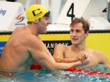 Gold medalist, Cameron McEvoy of Qld celebrates with Tommaso D'Orsogna of Qld following the Men's 100m Freestyle Final during the day five of the Australian National Swimming Championships on April 7, 2015.
