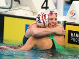 Gold medalist, Emily Seebohm of Qld celebrates with Madison Wilson of Qld following the Women's 50m Backstroke Final during the day five of the Australian National Swimming Championships at Sydney Olympic Park Aquatic Centre on April 7, 2015 in Sydney, Australia.