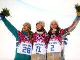 (L-R) Silver medalist Torah Bright, gold medalist Kaitlyn Farrington of the United States and bronze medalist Kelly Clark of the United States celebrate during the flower ceremony for the Snowboard Women's Halfpipe Finals on day five of the Sochi 2014 Winter Olympics at Rosa Khutor Extreme Park.