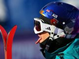 Russ Henshaw pokes his tongue out at the end of the Freestyle Skiing Men's Ski Slopestyle Qualifications.