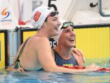 Cate Campbell (L) looks at the time after coming second to Bronte Campbell (R) in the Women's 50m Freestyle Final during day eight of the Australian National Swimming Championships on April 10, 2015.