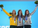 (L-R) Silver medalist Torah Bright of Australia, gold medalist Kaitlyn Farrington of the United States and bronze medalist Kelly Clark of the United States celebrate during the women's Snowboard Halfpipe medal ceremony.