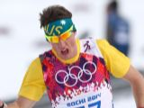 Callum Watson crosses the finishing line in the Men's 15 km Classic during day seven of the Sochi 2014 Winter Olympics at Laura Cross-country Ski & Biathlon Centre.