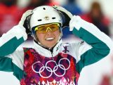 Danielle Scott reacts after her run in the Freestyle Skiing Ladies' Aerials Finals on day seven of the Sochi 2014 Winter Olympics at Rosa Khutor Extreme Park.