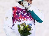 Bronze medalist Lydia Lassila celebrates during the flower ceremony for the Freestyle Skiing Ladies' Aerials Finals on day seven of the Sochi 2014 Winter Olympics.