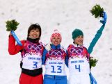 (L-R) Silver medalist Xu Mengtao of China, gold medalist Alla Tsuper of Belarus and bronze medalist Lydia Lassila celebrate on the podium during the flower ceremony for the Freestyle Skiing Ladies' Aerials Finals on day seven of the Sochi 2014 Winter Olympics.