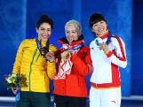 (L-R) Bronze medalist Lydia Lassila, gold medalist Alla Tsuper of Beralus and Silver medalist Mengtao Xu of China celebrate on the podium during the medal ceremony for the Freestyle Skiing Ladies' Aerials on day 8 of the Sochi 2014 Winter Olympics.
