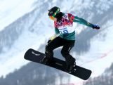 Belle Brockhoff competes during the Ladies' Snowboard Cross Seeding on day nine of the Sochi 2014 Winter Olympics at Rosa Khutor Extreme Park.