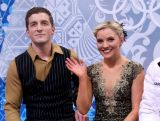 Danielle O'brien and Gregory Merriman  wait for their score during the Figure Skating Ice Dance Short Dance on day 9 of the Sochi 2014 Winter Olympics.
