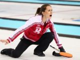 Anna Sidorovaof Russia competes during the Curling Women's Round Robin match between Russia and Great Britain on day ten of the Sochi 2014 Winter Olympics.