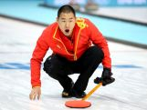 Rui Liu of China competes against Great Britian during the Men's Curling Round Robin on day ten of the Sochi 2014 Winter Olympics.