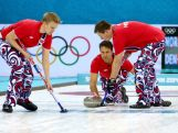 Jaavard Vad Petersson, Thomas Ulsrud and Christoffer Svae of Norway competes against Denmark during the Men's Curling Round Robin on day ten of the Sochi 2014 Winter Olympics.