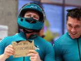 Pilot Heath Spence shows a message as Duncan Harvey looks on during the Men's Two-Man Bobsleigh on Day 10 of the Sochi 2014 Winter Olympics.