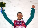 Silver medalist David Morris celebrates during the flower ceremony for the Freestyle Skiing Men's Aerials Finals on day ten of the 2014 Winter Olympics.
