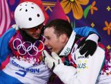 (L-R) Gold medalist Anton Kushnir of Belarus and silver medalist David Morris of Australia celebrate in the Freestyle Skiing Men's Aerials Finals on day ten of the 2014 Winter Olympics.