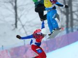 Pierre Vaultier of France (red bib), Hanno Douschan of Austria (yellow bib) and Jarryd Hughes (green bib) compete in the Men's Snowboard Cross 1/8 Finals on day eleven of the 2014 Winter Olympics.